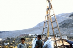 Tall ladder used (precariously) to photograph whole area. (1962, ID: cColepShechem014, Source: slide, Repository: NPAPH-project, Creator(s): Dan P. Cole)